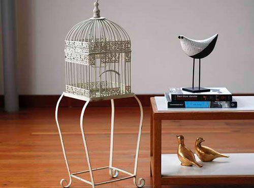Декоративна клетка за птици в интериора
